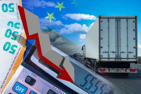 Decrease in freight turnover. Concept - drop in prices for transportation. EU flag next to calculator. Money. Concept - reduction of trade in the European Union. Truck rides on the road.