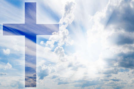 Christian cross on the background of heaven. Symbol of faith in God. Sun shines through the clouds. Concept - prayer. Catalocism Catholic religion Concept - help with above. Appeal to the Lord. Standard-Bild