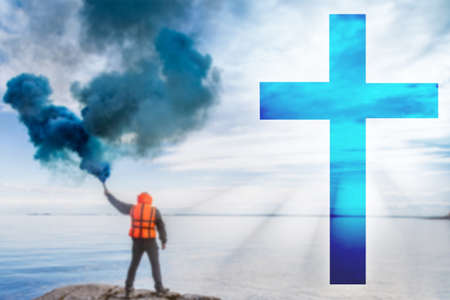 Calling God for help. Concept - man seeks help in religion. Cross as a symbol of religion. Man gives a signal of SOS. Guy with a smoke bomb near sea. Concept - got into trouble refers to the church