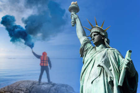 Guy with smoke bomb. Statue of Liberty as a symbol of New York. Concept - USA needs help. New York authorities are asking for help. Man sends a signal of SOS. America. United States calls for help.
