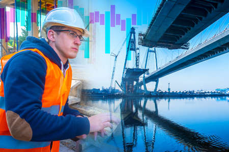 Construction of bridges. Engineer next to a bridge under construction. Architect represents the construction process. Road architecture. Building a bridge over a river. Builder comes up with project