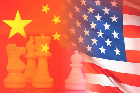 Political confrontation. Confrontation between the USA and China. International relationships. China in Geopolitics of America. Chess pieces next to the flags. Chess pieces symbolize political battle Imagens
