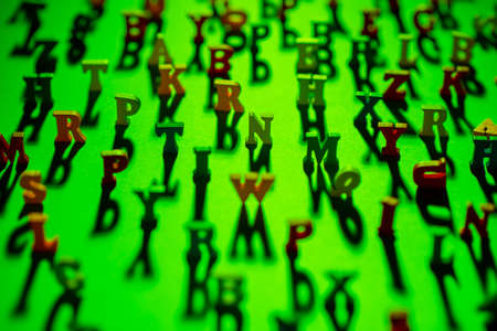 ABC pattern. Letters background in green. Letters are arranged chaotically. Background consists of 3D letters. Focusing on center frame. Character are blurred around edges. Pattern topic of education