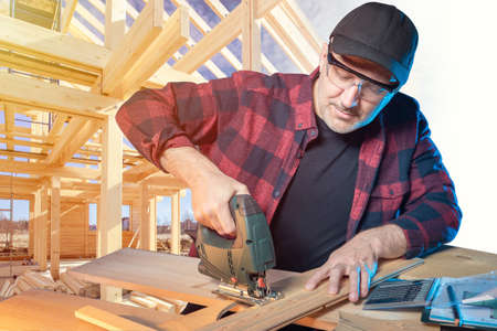 Work with a tree. Concept - construction of frame houses. Man prepares beams for construction. Concept - carpenter prepares furniture for a new home. Joiner on the background of a construction site