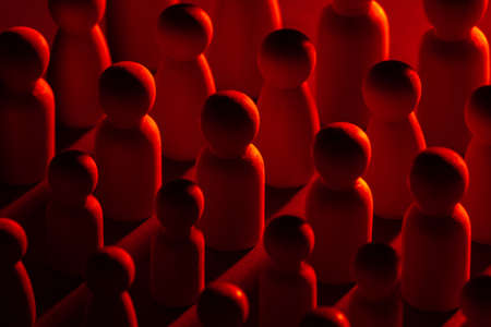 Figures of people in red neon light. Red light as a symbol of trouble and layoffs. Concept - they were all fired from work. Mass layoffs in labor market. Job loss. Staff cuts due to the crisis.