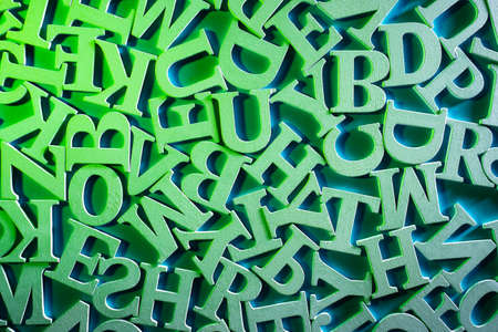 Latin volumetric letters on a plane. Top view of letters of alphabet. Alphabet as a symbol of learning english. Concept - getting education in english. Preschool education in english.