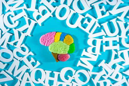 Memory development. Human brain in midst of various letters. Illustration with brain symbolizes memory training. Teaching person to remember something. Concept - courses on intellectual development