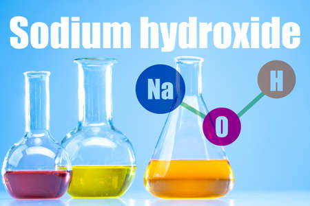NaOH. The inscription nadrium hydroxide. Test tubes with multi-colored substances. NaOH on one of the test tubes. Concept - the use of alkali in soap making. Caustic substance. Caustic soda