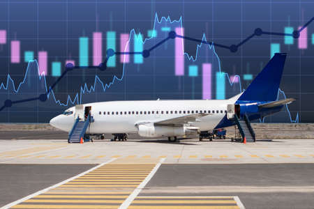 Fluctuating graphics near the plane. Concept - an increase in the riskiness of investments air. A growing chart as a symbol of increased risk. Falling shares of air carriers. Aircraft Production