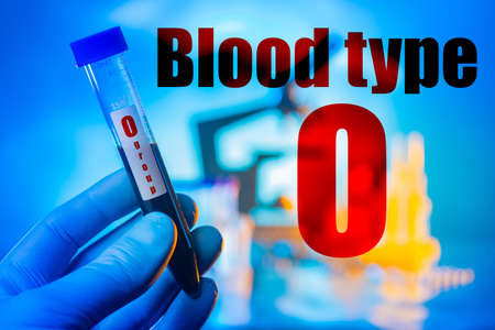 Inscription blood group 0. Test tube with human blood. Test tube on the background of the laboratory. Determination of the number of electrocytes in the blood. Blood type logo. Agglutinogens