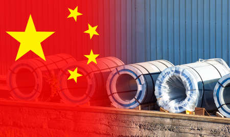 China flag next to rolls of steel. Steel rolls in open air. Concept - export of metal from China. Purchase of metal from People's Republic of China. Export of metal from PRC. Wholesale of steel.