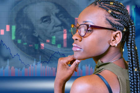 Girl is watching the stock price. Concept - woman analyzes financial market. Businesswoman. African American is thinking about buying stocks. Concept - a girl wants to buy stocks. Dollars. Franklin