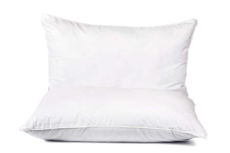 Two white pillows for sleeping. Pillows without pillowcase on a white background. Bed dress. Concept - sale of anatomical pillows. Sleep. Sleeping accessories. Making anatomical cushion.