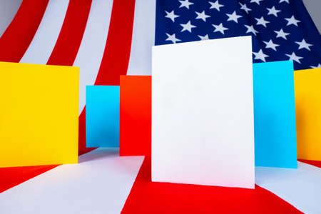 Multicolored cards on USA flag background. Multi-colored cards represent many choices. Concept - political pluralism in United States of America. Pluralism for voter. Many options for voter