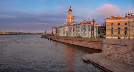 Saint-Petersburg in the white nights. Vasilievsky Island in the early morning. Cities of Russia. Dawn in St. Petersburg. Kunstkamera on the background of a beautiful sky. Petersburg rivers. Neva river