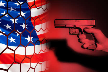 Shot USA. Man with a gun next to the flag of America. Lattice on the flag of the United States. Free carrying weapons. Hand with a gun. Concept - Shooting Prison. Concept - selling weapons in America