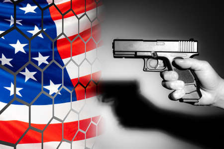 US flag is visible through the trellis. The concept is a crime in America. Murder. A man with a gun as a symbol of a killer. Concept - the arms trade. Concept - uncontrolled sale of weapons