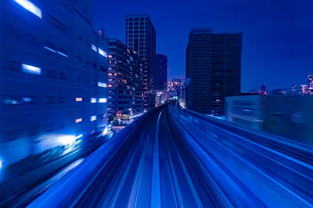 Japan. Railway in Tokyo. Flyover for trains in the evening. Concept - rails for high-speed trains. Concept - travel on high-speed trains. Tokyo cityscape. The capital of Japan in the evening Standard-Bild
