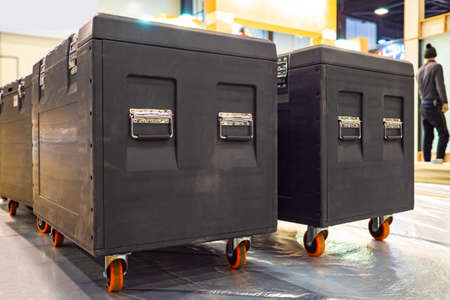 Black boxes for musical equipment. Concept - rental of concert equipment. Concept - sale of cases for the transportation of equipment. Musical accompaniment services. Blackcofra for music speakers
