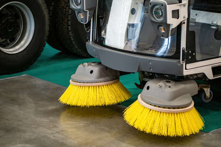 Sweeping cleaner machine. Sweeper brushes close-up. Street cleaning machine. Special technique for shaping the streets. Concept - sale of a sweeping cleaner machine. Equipment for cleaning streets