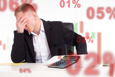 Frustrated investor. Concept - investor is dissatisfied with the unfulfilled forecast. Trader with a calculator. Trader has lost his money. Trader lost money of a hedge fund while investing.