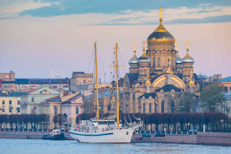 Churches Saint Petersburg. Russia on summer day. Church of Assumption of Holy Mother of God. Assumption Cathedral in Saint Petersburg. Sailing ship off coast of Petrburg. Orthodox Cathedral in Russia
