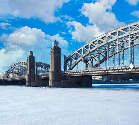 Winter landscape Saint Petersburg. Bridge in Russia. Bolsheokhtinsky bridge on a winter day. Peter Great Bridge on sky. Frozen Neva in Saint Petersburg. Bridgework in Russia. Winter travel in Russia Stockfoto