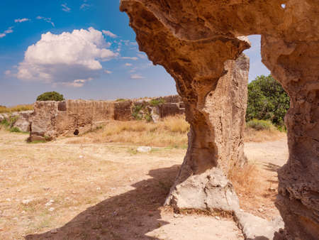 Paphos city in Cyprus. Remains of a medieval wall. Excursions in Tomb of Kings. Fragment of archaeological park of Cyprus.
