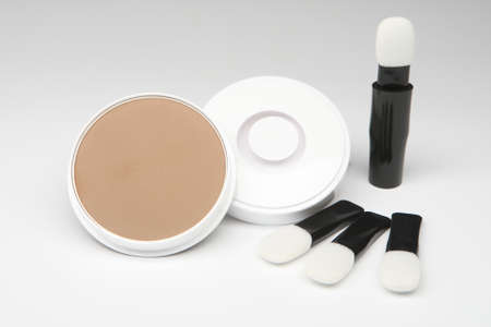 Powder for the head. Baldness masking cosmetic set. Women's powder on a white background. Concept - sale of women's cosmetics. Using face powder. Women's cosmetics store. Fight hair loss