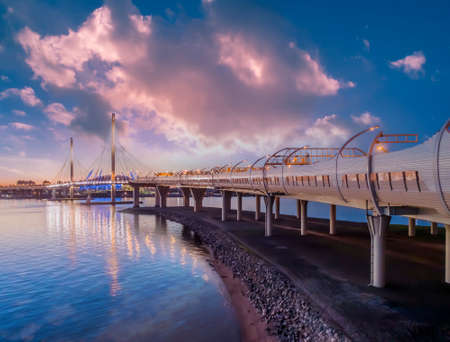 Morning Saint Petersburg. Road Russia. Automotive bridge bottom view. Cable-stayed bridge over bay. Traveling around Saint Petersburg by car. Bridge to Krestovsky Island. Roads of Russian Federation