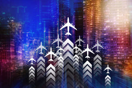 Business travel. Planes on a downtown backdrop symbolize corporate travel. Concept - business travel. Corporate business trip. Night city with skyscrapers. Air flights for corporate purposes