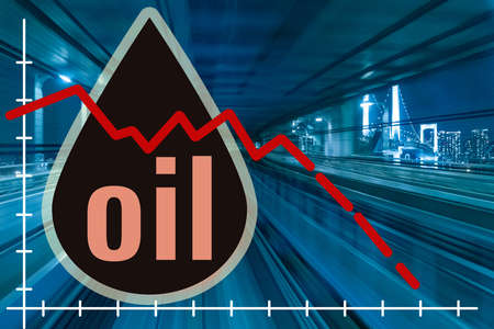 Oil prices. Concept - reduction of prices for oil products. The cost of diesel fuel. Oil logo on the background of the railway. A drop. Town. Petrol. Graph indicators are declining. Petrolium