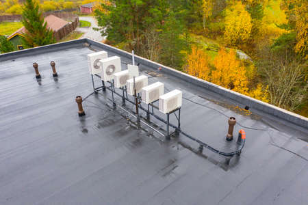 Outdoor air conditioning units on roof. Air conditioning system opens onto roof. Concept - air purification system in building. Flat roof of building top view. Sale oxygen purification equipment.