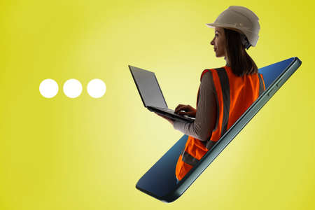 Website or application architect concept. An architect girl with a laptop. Portrait of civil engineer in a white helmet. Website of a construction company. Mobile applications for architects.