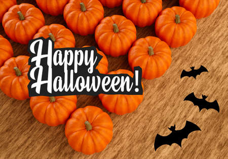Happy Halloween text next to pumpkins and bats. Happy Halloween logo on wooden background. Symbols of All Saints Eve. An invitation to a Halloween party. Holiday of spirits and ghost. 3d image