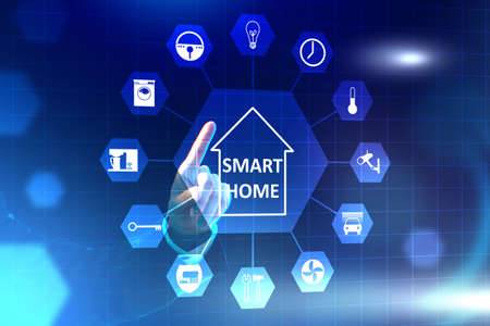 Person controls the smart home. Man's hand next to smart home logo He controls smart home using menu. Electronics control panel on a virtual screen.Panel for control IOT house. Blue background.