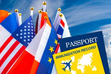 Immunization record next to passport. Flags symbolize internationality and globality. Immunization record as a symbol of virus vaccination. virus stamp in international passport