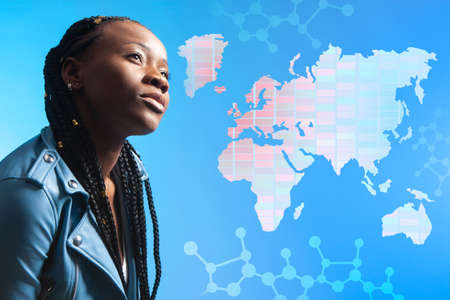 Human races, nationalities, and genetic differences. African-American woman against the background of a world map and genome map. Human genome. Human populations. Genes and hereditary traits.