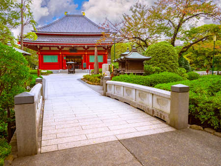 Ancient temple in Tokyo. Asakusa Temple in Japan. Bridge over river in Asakusa area. Sensoji Buddhist Temple. Tokyo in sunny weather. Cities of Japan. Japan traditional attractions. Editorial