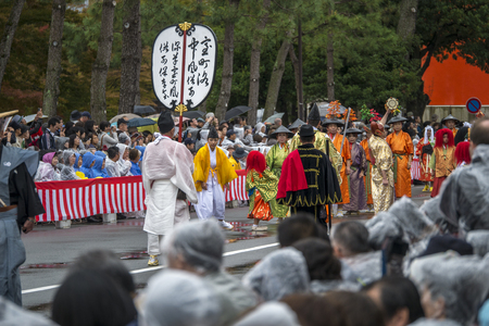 maiko: KYOTO, JAPAN - OCT 22: The Jidai Matsurihistorical parade October 22rainy day, 2014 in Kyoto, Japan. It is one of Kyotos renowned three great festivals. Editorial