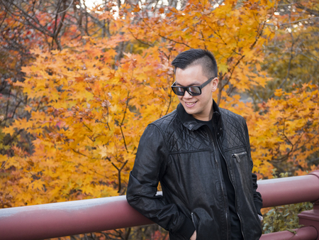 Preview Save to a lightbox  Find Similar Images  Share Stock Photo: a man relaxing with a beautiful Japan , Nikko autumn tree . focus on the model . Japan autumn set Stock Photo