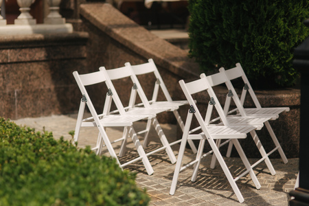White chair on wedding ceremony. summer wedding decoration outside