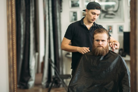 Male client getting haircut by hairdresser. barbershop Stock Photo