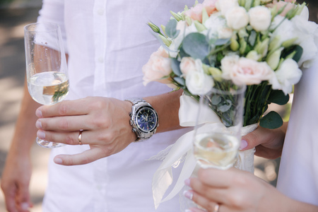 Groom hold a glass with champagne. Bouquet of flowers Stok Fotoğraf