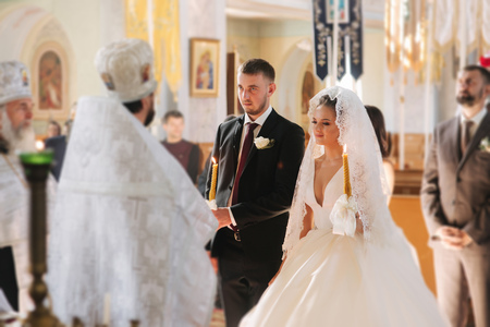Groom and bride in the church. Newlyweds on their wedding 스톡 콘텐츠