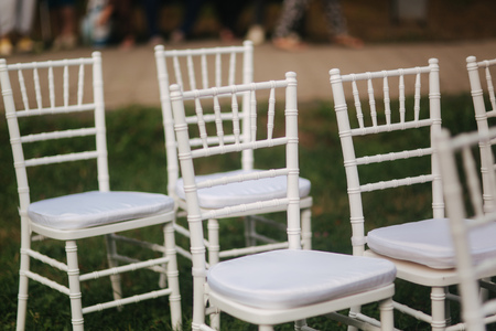 White chair on wedding ceremony. Summer wedding decoration outside 写真素材