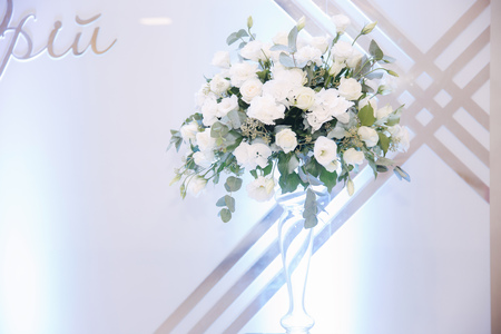 Composition of flowers on wedding in the restaurant. Inside