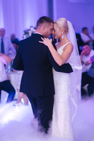First dance of stylish wedding couple. Handsome groom and elegant bride in the restaurant