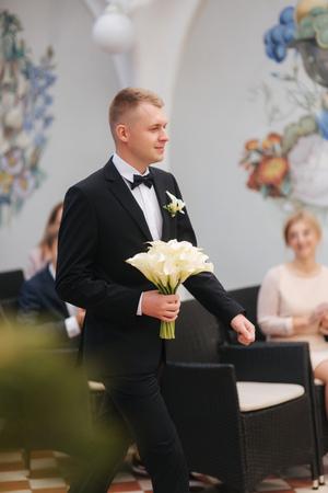 Groom go to bride on wedding ceremony Imagens