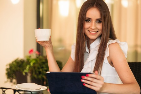 Young beautiful girl use a laptop during a break at work. Summer